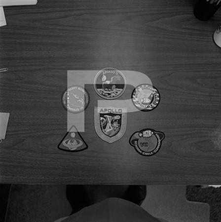 Badges - badges on a guys desk