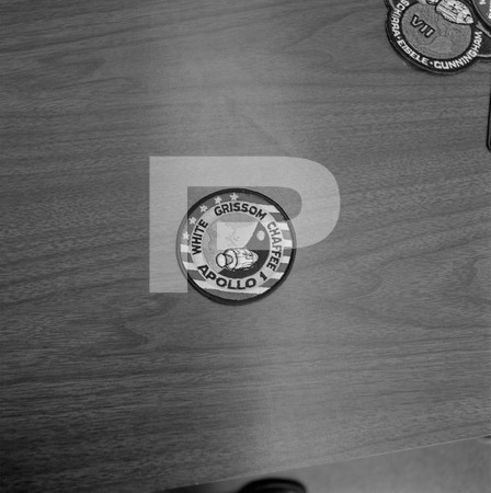 Badges - badges on a guys desk