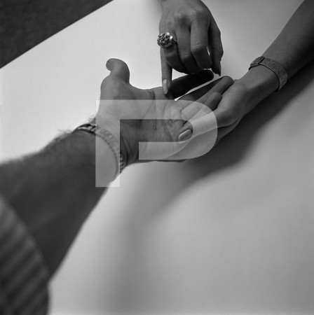 Future Feature - close-up of man and womans hands with rings and watches