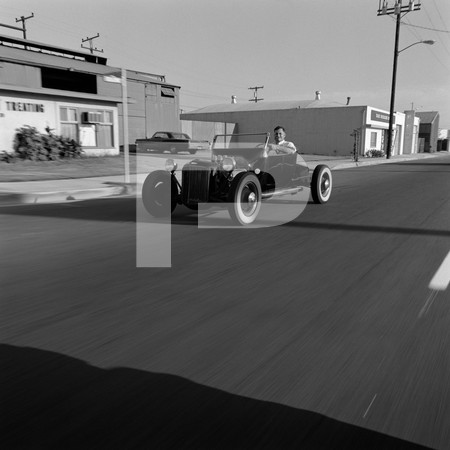 1972 Ed Iskenderian Camshaft Manufacturer - Gardena California - Ed driving roadster on road and front of shop