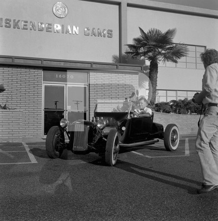 1972 Ed Iskenderian Camshaft Manufacturer - Gardena California - Ed and roadster drivning in front of his building